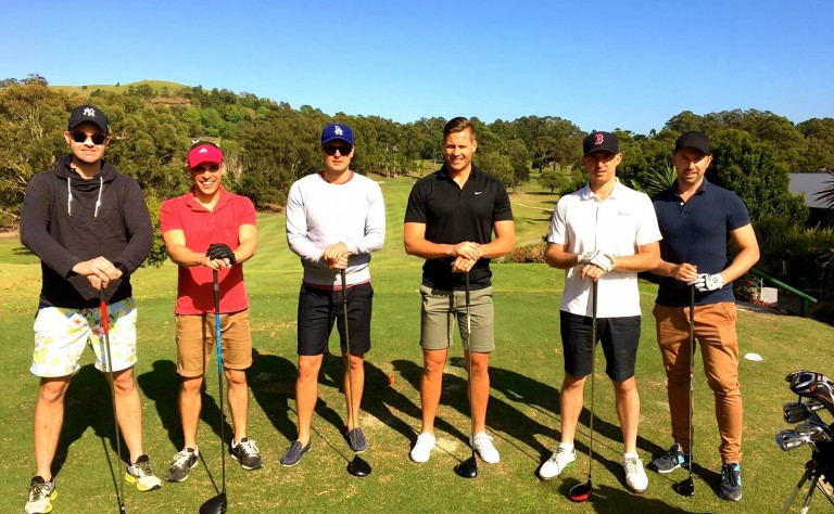lads playing golf