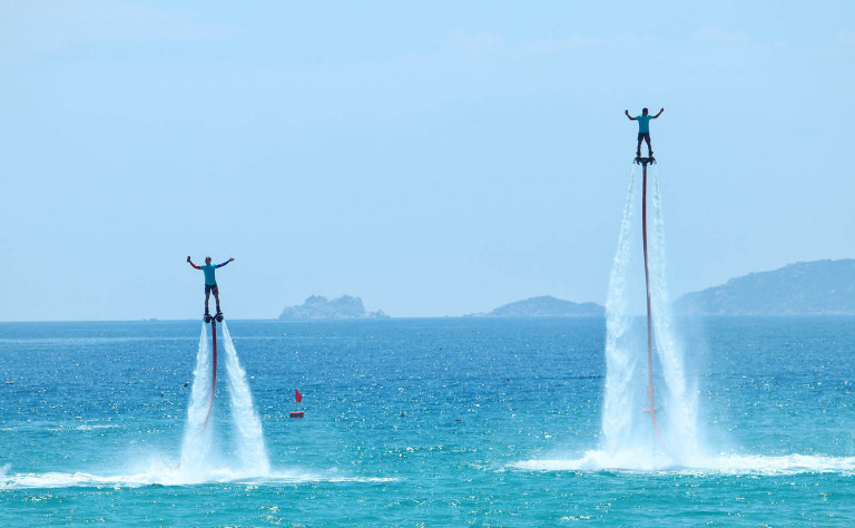 1 two people flyboarding