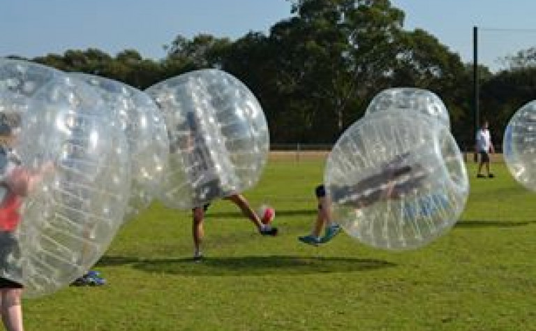 Bubble soccer on oval